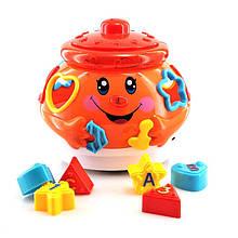 """Развивающая музыкальная игрушка горшочек-сортер """"Танцующий горшочек"""" 0915 оранжевый"""