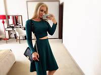 Костюм трикотажный юбка и кофта зеленого цвета