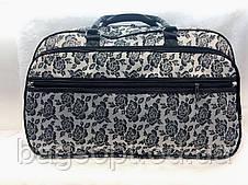 Жіноча дорожня сумка-саквояж з квітами текстильна містка