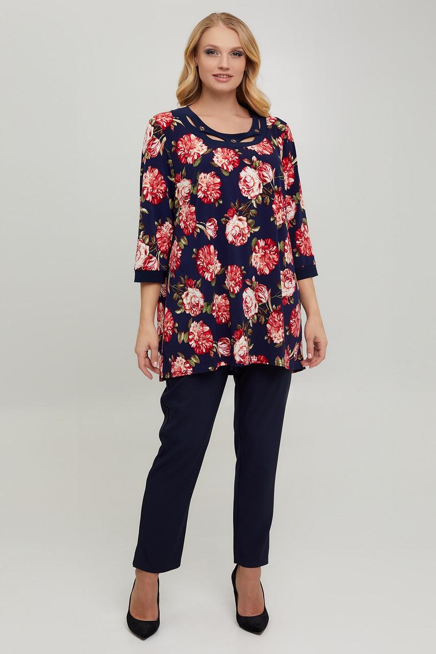 Нарядна жіноча блуза з трикотажу масло