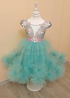 Нарядное детское платье украшенное кружевом