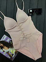 Женский сплошной купальник в рубчик со шнуровкой на груди 51kl364
