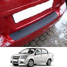 Пластикова захисна накладка на задній бампер для Chevrolet Aveo T250 сєдан 2006+