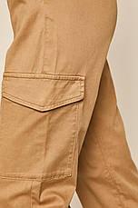 Бежевые брюки женские с карманами карго, фото 3