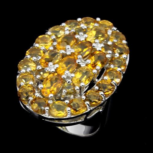 Серебряное кольцо с золотистыми цитринами