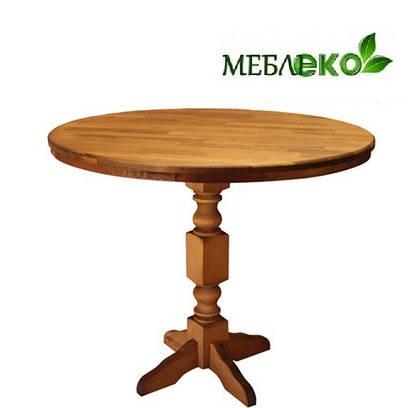 Стол круглый из натурального дерева на одной ноге.