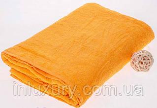Махровая простынь желтого цвета