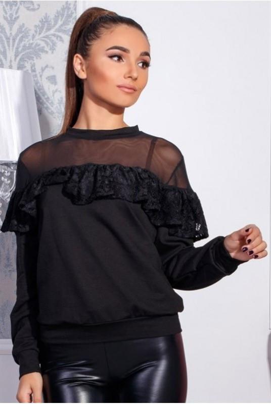 Трикотажная блузка с воланом