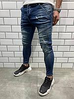 Мужские зауженные джинсы светло-синего цвета поцарапаные