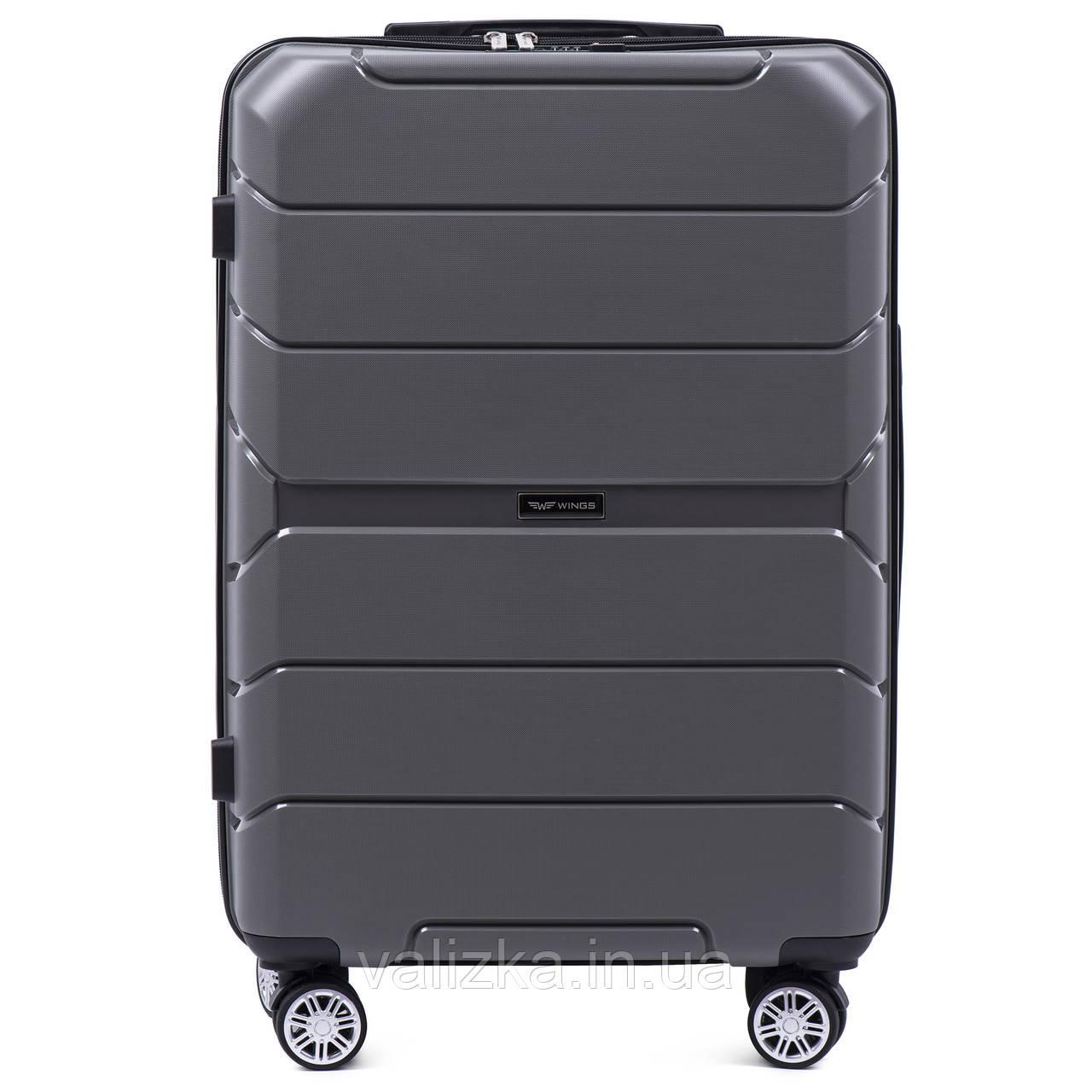 Средний чемодан серого цвета из полипропилена премиум серии на 4-х двойных колесах с ТСА замком