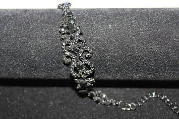 Роскошный черный браслет с камнями