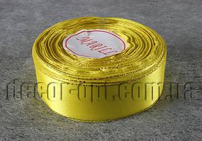 Лента атласная желтая с люрексом  2,50 см 36 ярд 15