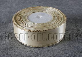 Лента атласная кремовая с золотым люрексом  2,50 см 36 ярд