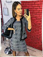 Модный деловой женский костюм-тройка (майка,юбка и пиджак) серого цвета.