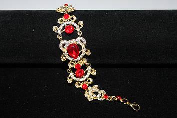 Стильный свадебный браслет золотистый с красными камнями