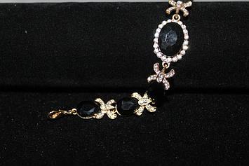 Изящный браслет золотистый с черными камнями