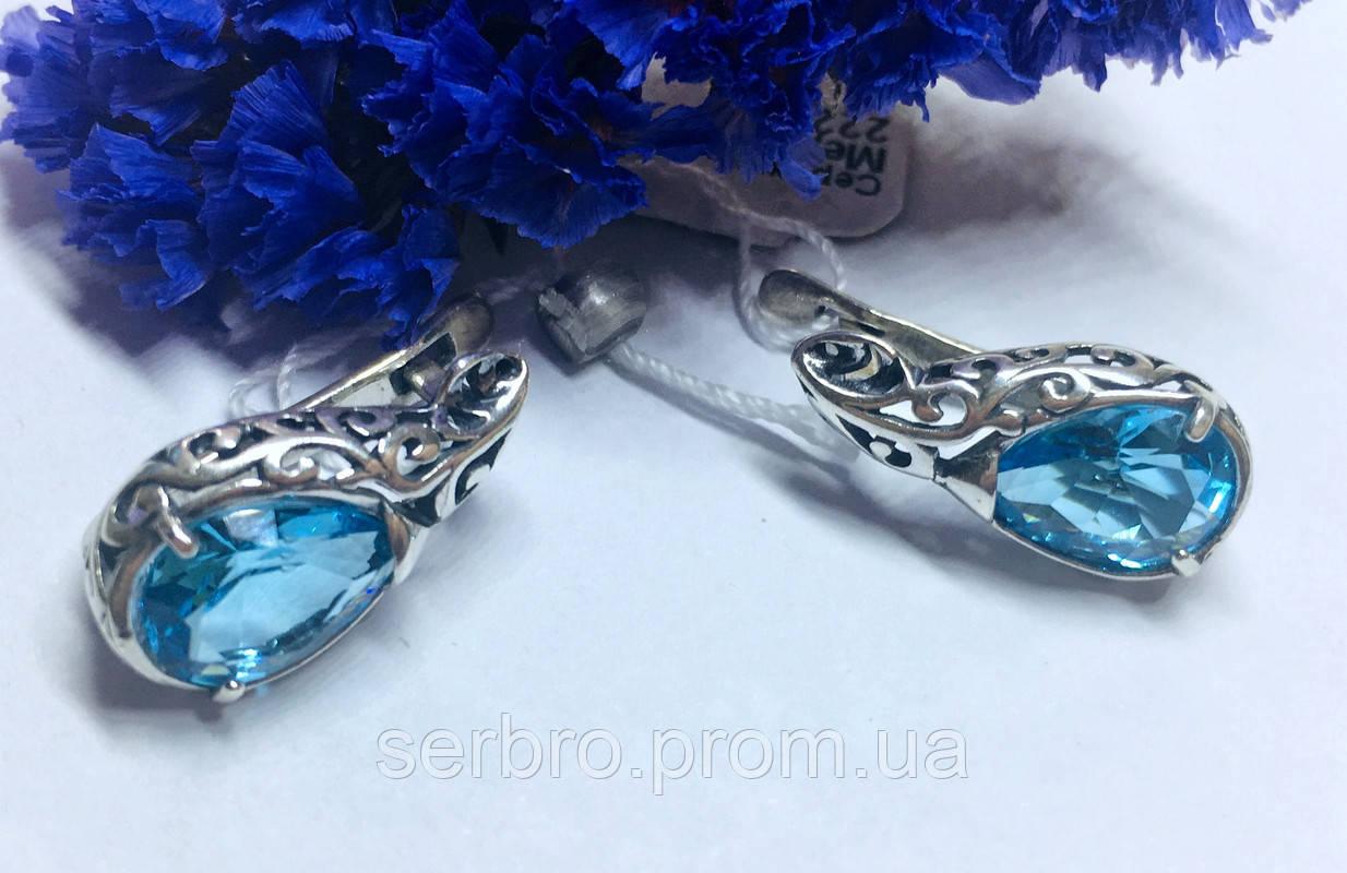 Сережки з візерунками і блакитним цирконом Медіна