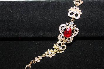 Великолепный золотистый браслет с красными камнями горный хрусталь
