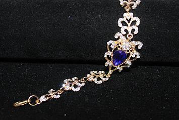 Восхитительный золотистый браслет с синими камнями горный хрусталь