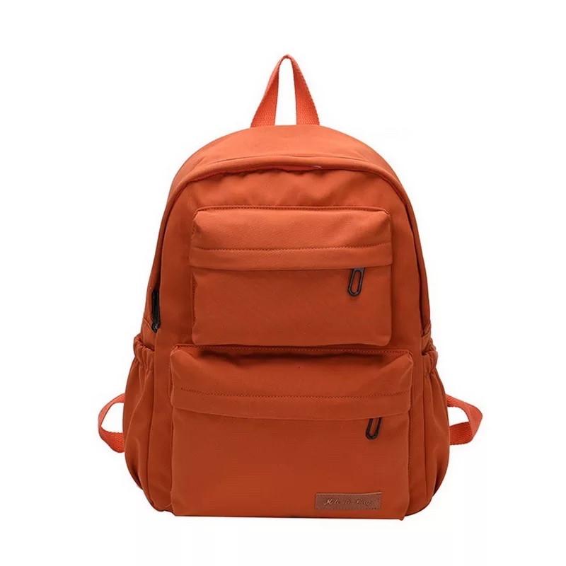 Однотонный оранжевый рюкзак женский с водонепроницаемой пропиткой.
