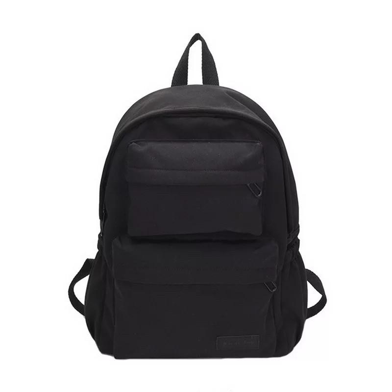 Молодежный черный рюкзак однотонный с карманами.