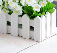Деревянный кашпо в виде заборчика под цветы