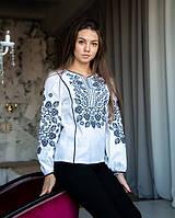 Нарядная белая льняная блуза с этнической вышивкой