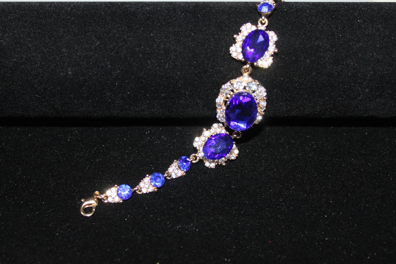 Шикарный золотистый браслет с синими камнями