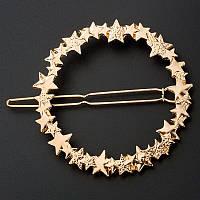 Металева шпилька у формі кругасо здездочками (у золоті і сріблі)