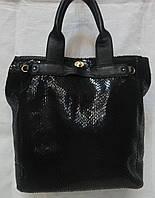 Женская сумка из лазерной кожи.