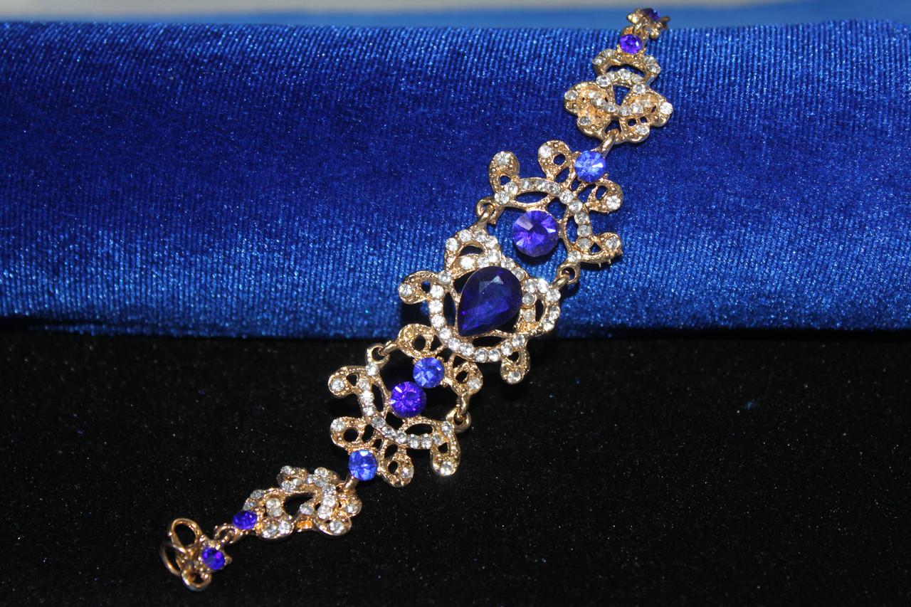 Роскошный золотистый браслет на руку с синими камнями