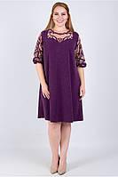 Платье нарядное трапециевидного силуэта из блестящего трикотажа длиной до колен сиреневого цвета