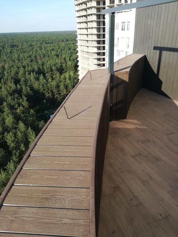 Фасад и парапет из сайдинга Polymer & Wood из ДПК , пгт. Бортничи