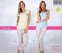 Женский костюм пижама с футболкой и штанишками.