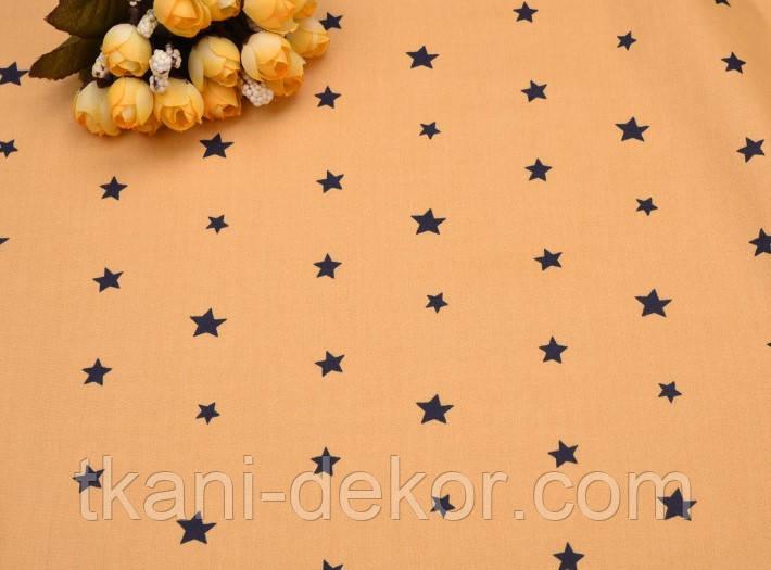 Сатин (бавовняна тканина) зірки чорні на гірчичному (нові)