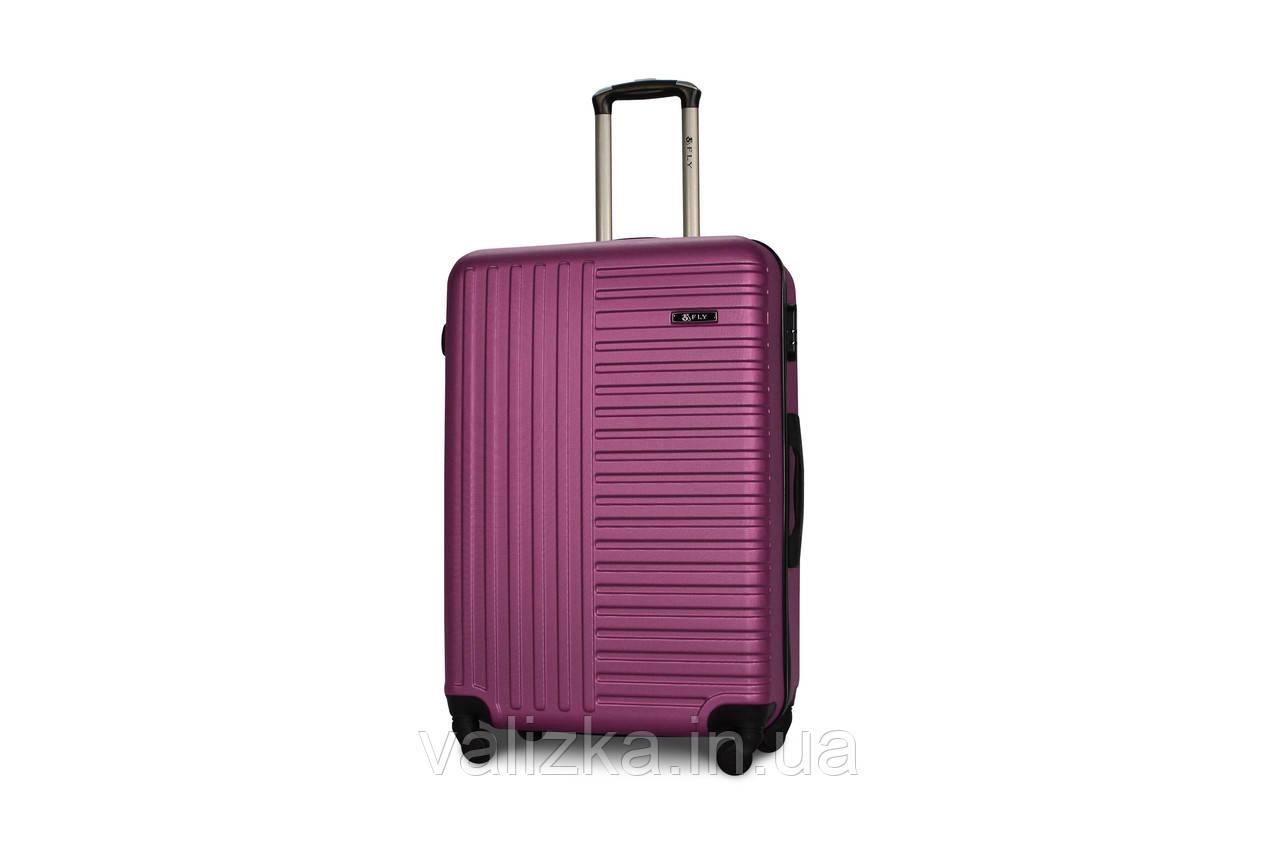 Чемодан из противоударного пластика большого размера Fly на 4-х колесах темно-фиолетового цвета.