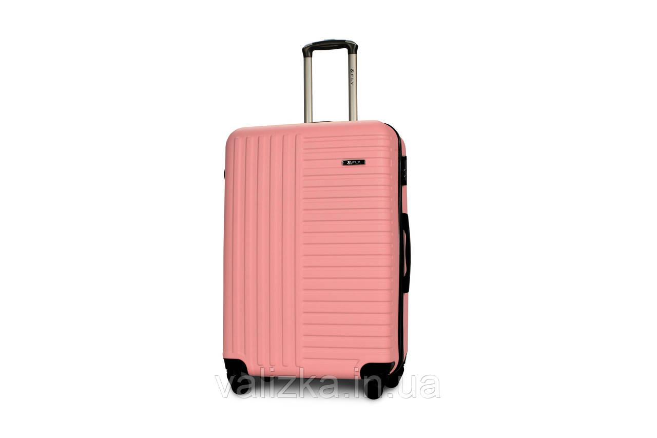 Чемодан из противоударного пластика большого размера Fly на 4-х колесах светло-розового цвета.