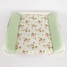Пеленальный матрас с зеленым бортиком цветы