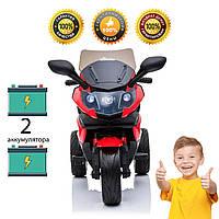 Детский трехколесный мотоцикл с двумя аккумуляторами.