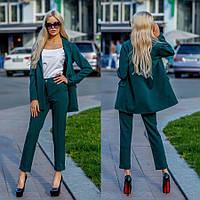 Офисный костюм зеленого цвета 42,44,46