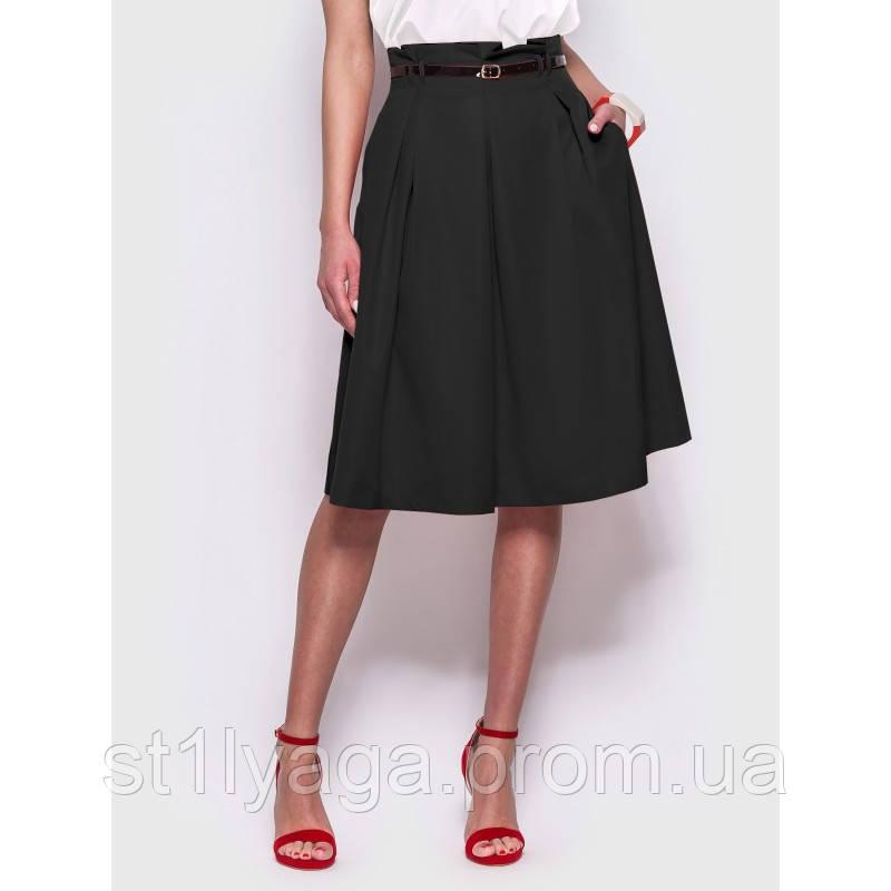 Стильная юбка длиной миди с удобными карманами по бокам