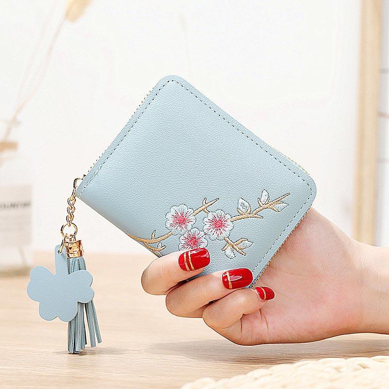 Небольшой женский голубой кошелек с вышивкой код 392