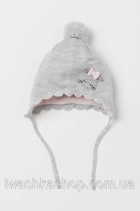 Вязаная шапка с завязками и флисовой подкладкой на девочку 6 - 12 месяцев, 74 - 80 р., H&M