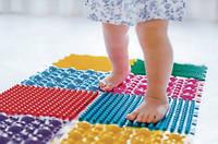 Масажні та ортопедичні килимки