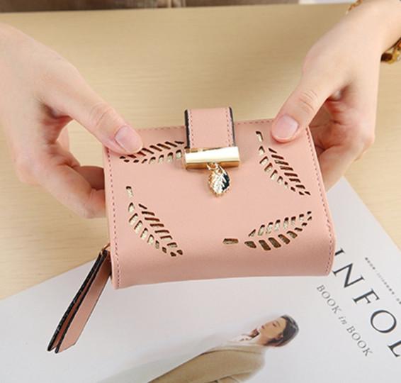 Невеликий гаманець з перфорацією, застібка кнопки + блискавка (0842) Рожевий