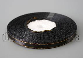 Лента атласная черная с золотым 0,6 см 36ярд 39