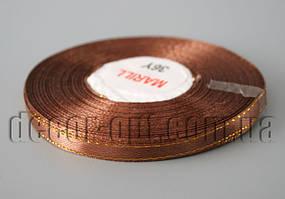 Лента атласная коричневая с золотым 0,6 см 36ярд 31