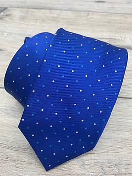 Галстук голубой в цветные точки.