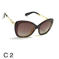 Сонцезахисні окуляри з поляризаційною лінзою Gucci