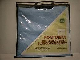 Комплект постільної білизни в дитячу ліжечко.